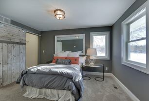 Contemporary Guest Bedroom with Carpet, Paint, Standard height, flush light, Casement, double-hung window, Barn door