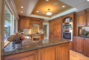 Craftsman Kitchen with can lights, built-in microwave, Stone Tile, Framed Partial Panel, Limestone Tile, Ceramic Tile, Galley