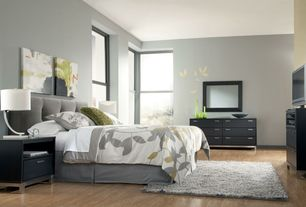 Contemporary Master Bedroom with Laminate floors, Narrow-leg end table - chocolate, Built-in bookshelf, Area rug