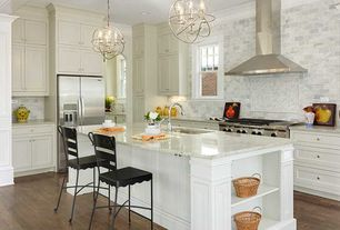 Traditional Kitchen with Breakfast bar, Simple granite counters, L-shaped, Inset cabinets, Crown molding, Pendant light