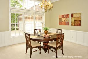 Traditional Dining Room with Crown molding, double-hung window, Chandelier, picture window, High ceiling, Carpet