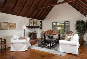 Craftsman Living Room with Exposed beam, High ceiling, Hardwood floors