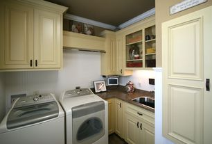 Traditional Laundry Room with travertine tile floors, Built-in bookshelf, Crown molding