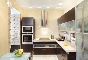 Contemporary Kitchen with L-shaped, Standard height, Wall Hood, drop-in sink, electric cooktop, limestone floors, flush light