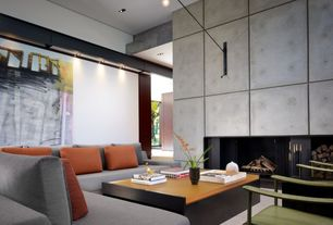 Contemporary Living Room with Wall sconce, Concrete floors