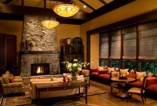 Craftsman Living Room with High ceiling, Exposed beam, Window seat, stone fireplace, Bamboo roman shades, Fireplace, Casement