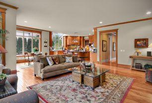 Traditional Great Room with Casement, Pendant light, Standard height, Hardwood floors, can lights, Built-in bookshelf