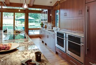 Contemporary Kitchen with Mohawk Fairview Butterscotch 7 mm Thick x 7-1/2 in. Width x 47-1/4 in. Length Laminate Flooring