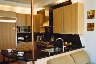 Modern Kitchen with gas range, Stone Tile, can lights, Simple Granite Tile, U-shaped, limestone floors, Flush, Wall Hood