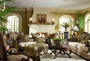 Traditional Living Room with Arched window, Frontgate Joanie Tufted Ottoman, Paris Medallion Table Lamp, Paint, Fireplace