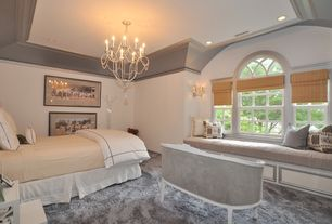 Traditional Master Bedroom with Crown molding, Wall sconce, Window seat, specialty window, can lights, Chandelier, Carpet