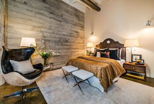 Eclectic Master Bedroom with Exposed beam, Area rug, Wall sconce, Arne jacobsen egg chair, Wood paneled wall, Concrete floors