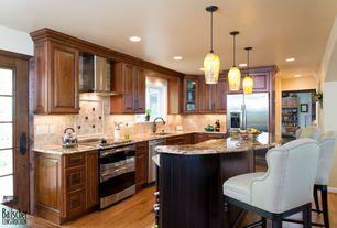 Traditional Kitchen with French doors, Kitchen island, Raised panel, Stone Tile, Breakfast bar, Flush, Pendant light