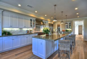 Traditional Kitchen with French doors, European Cabinets, Crown molding, Breakfast bar, Stone Tile, Glass panel, L-shaped