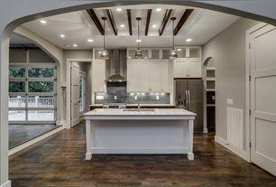 Traditional Kitchen with gas range, full backsplash, Flat panel cabinets, Wall Hood, Pendant light, specialty door, Flush