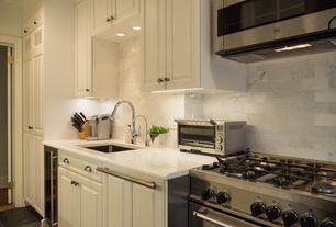 Contemporary Kitchen with Quartz counters, Complex Marble Tile, High ceiling, Crown molding, slate tile floors, flush light