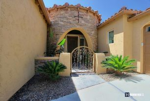Mediterranean Exterior of Home with exterior tile floors, Fence, Gate, Pathway