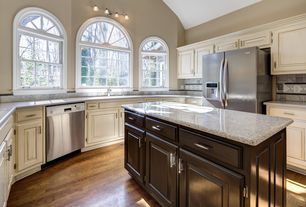 Traditional Kitchen with Stone Tile, U-shaped, Simple granite counters, Raised panel, Framed Partial Panel, Wall sconce