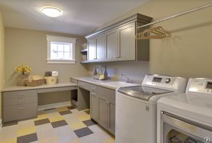 Traditional Laundry Room with Hanging Bar, Marmoleum modular, simple granite floors, Casement, Standard height, laundry sink