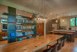 Contemporary Dining Room with Chandelier, Built-in bookshelf, Hardwood floors, Pendant light