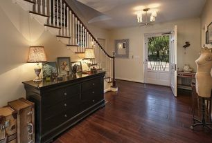 Eclectic Entryway with Soho chandelier, Wildon home carbon 6 drawer dresser, Wall sconce, Glass panel door, six panel door