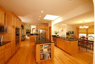 Craftsman Kitchen with Kitchen island, Raised panel, Simple granite counters, Hardwood floors, Skylight, Flush, U-shaped