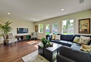 Contemporary Living Room with Casement, can lights, Standard height, Hardwood floors, French doors
