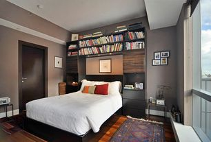Modern Master Bedroom with Tag furnishings group foster end table, Built-in bookshelf, Malm, Vintage caucasian soumak rug