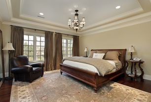 Traditional Master Bedroom with Crown molding, Casement, Hardwood floors, can lights, Standard height, Chandelier