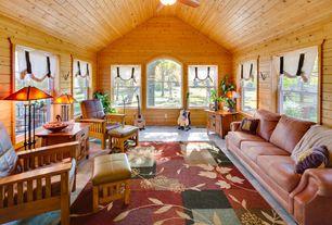 Craftsman Living Room with Cathedral ceiling, Built-in bookshelf, Ceiling fan, Concrete tile , flush light