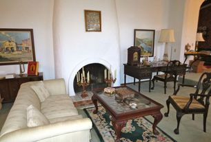 Traditional Living Room with Built-in bookshelf, Carpet, High ceiling, Fireplace, Cement fireplace