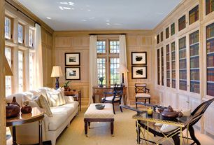Traditional Home Office with Casement, Standard height, Carpet, Built-in bookshelf, Crown molding