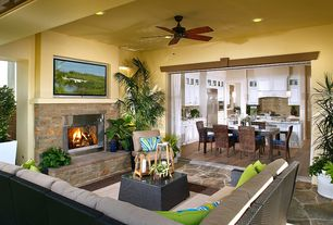 Traditional Patio with Indoor/outdoor living, stone fireplace, Fence, exterior stone floors