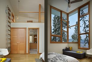 Contemporary Guest Bedroom with Ceiling fan, French doors, High ceiling, specialty window, Window seat, Loft, Hardwood floors