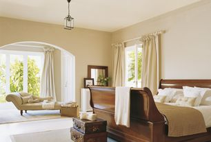 Traditional Master Bedroom with French doors, Pendant light, Built-in bookshelf, Crown molding, Concrete floors