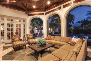 Tropical Porch with Transom window, French doors, Fence, Screened porch, exterior stone floors, Raised beds