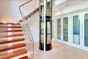 Contemporary Staircase with Wall sconce, High ceiling, Floating staircase, Glass staircase, Hardwood floors