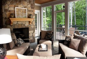 Traditional Porch with exterior terracotta tile floors, stone fireplace, Wrap around porch, Natural light, Wood ceiling