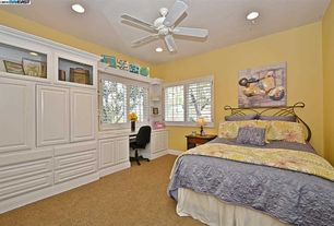 Traditional Guest Bedroom with Built-in bookshelf, Carpet, Ceiling fan