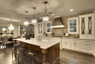 Contemporary Kitchen with Flat panel cabinets, Crown molding, Breakfast bar, Silver Chain Link Mirror, Pendant light, Flush
