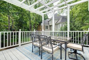 Traditional Deck with Outdoor area rug, Trellis, double-hung window, Outdoor dining set, Casement, Deck Railing