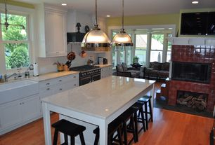 Traditional Kitchen with Custom hood, Flat panel cabinets, Farmhouse sink, Subway Tile, Breakfast bar, Kitchen island
