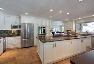 "Traditional Kitchen with 21"" Tall Glass Pedestal Cake Stand, Kitchen island, Undermount sink, Flat panel cabinets"