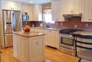Traditional Kitchen with Complex marble counters, built-in microwave, Standard height, Framed Partial Panel, Raised panel
