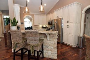Traditional Kitchen with Complex granite counters, Crown molding, Raised panel, Pier 1 imports kubu barstool, Pendant light