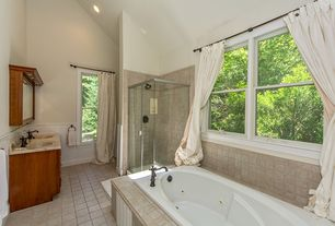 Traditional Master Bathroom with Wainscotting, stone tile floors, Wall Tiles, High ceiling, Antique bronze finish fixtures