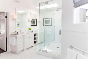 Traditional Master Bathroom with Master bathroom, Flat panel cabinets, Double sink, specialty door, Crown molding, Skylight