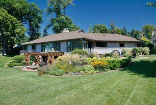 Traditional Landscape/Yard with Casement, exterior stone floors, Deck Railing, Raised beds, Trellis