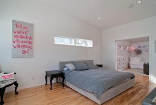 Modern Guest Bedroom with Convenience concepts french country end table, Hardwood floors, Sunpan modern abacus wingback bed