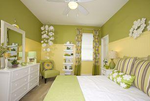 Contemporary Guest Bedroom with Ceiling fan, Built-in bookshelf, Wainscotting, Carpet, flush light